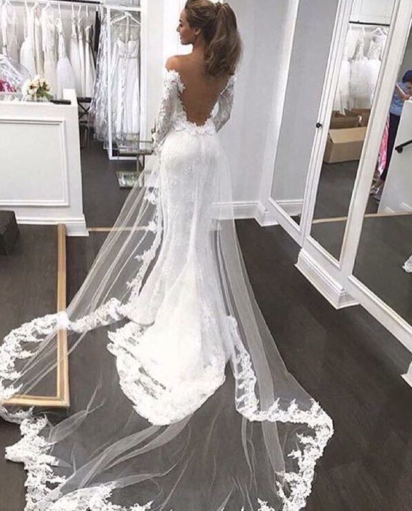 Backless Wedding Dress Lace And Veiled Detail Over Skirt With Images Wedding Dresses Wedding Dress Long Sleeve Lace Weddings
