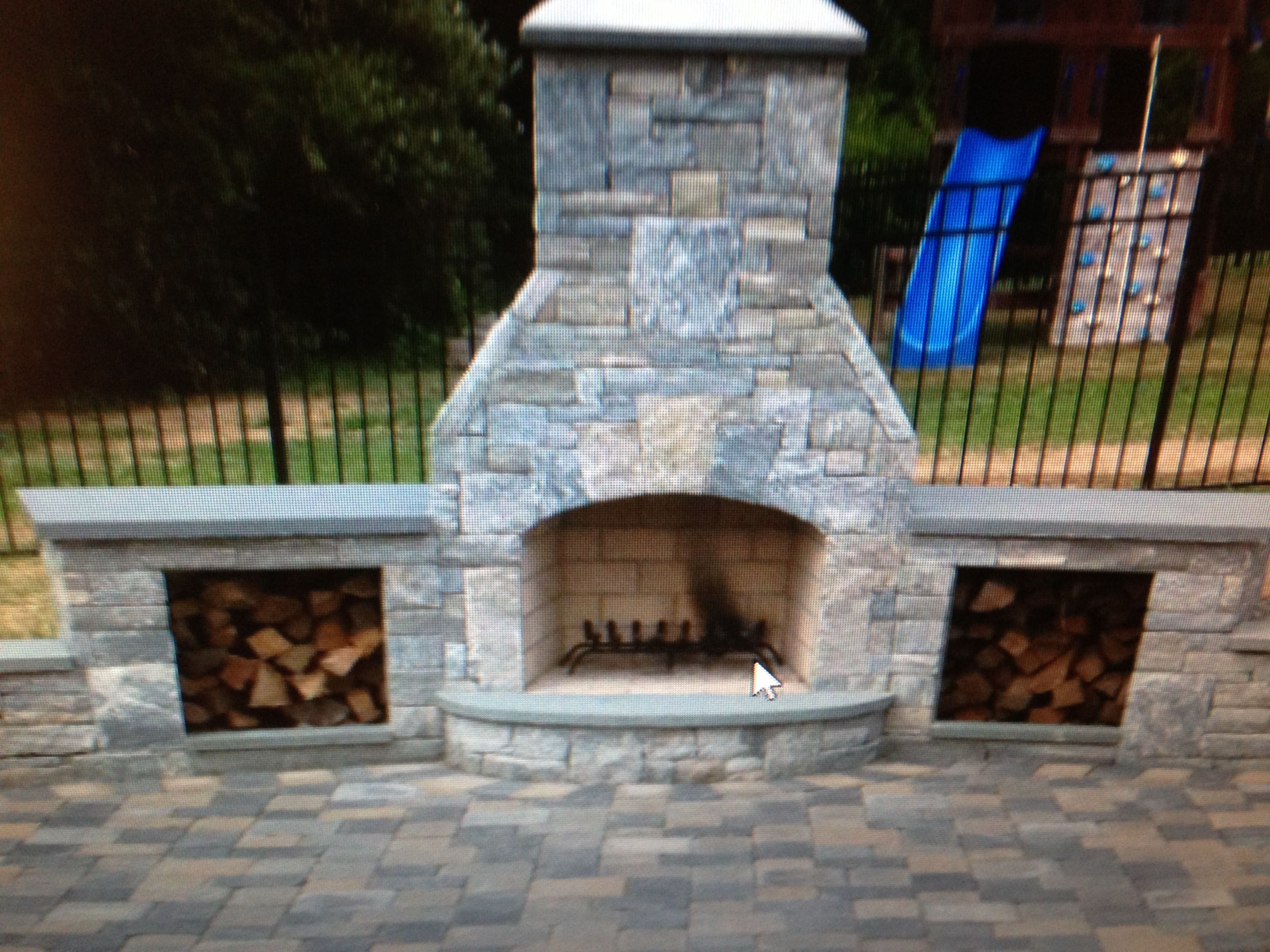 The Natural Stone Of This Outdoor Fireplace With Curved Hearth And Twin Wood Bins Mixes Well With Multi Colored Pav Backyard Patio Outdoor Fireplace Fireplace
