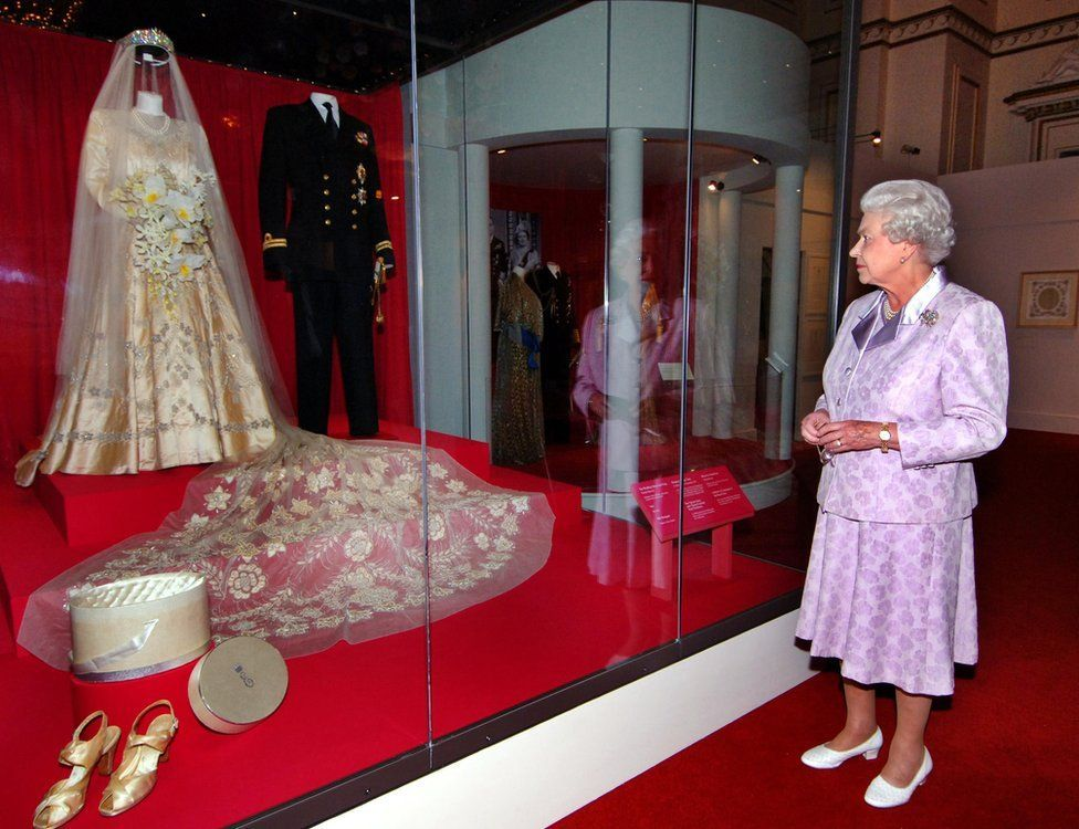 The Queen views her 1947 wedding gown and 13foot bridal