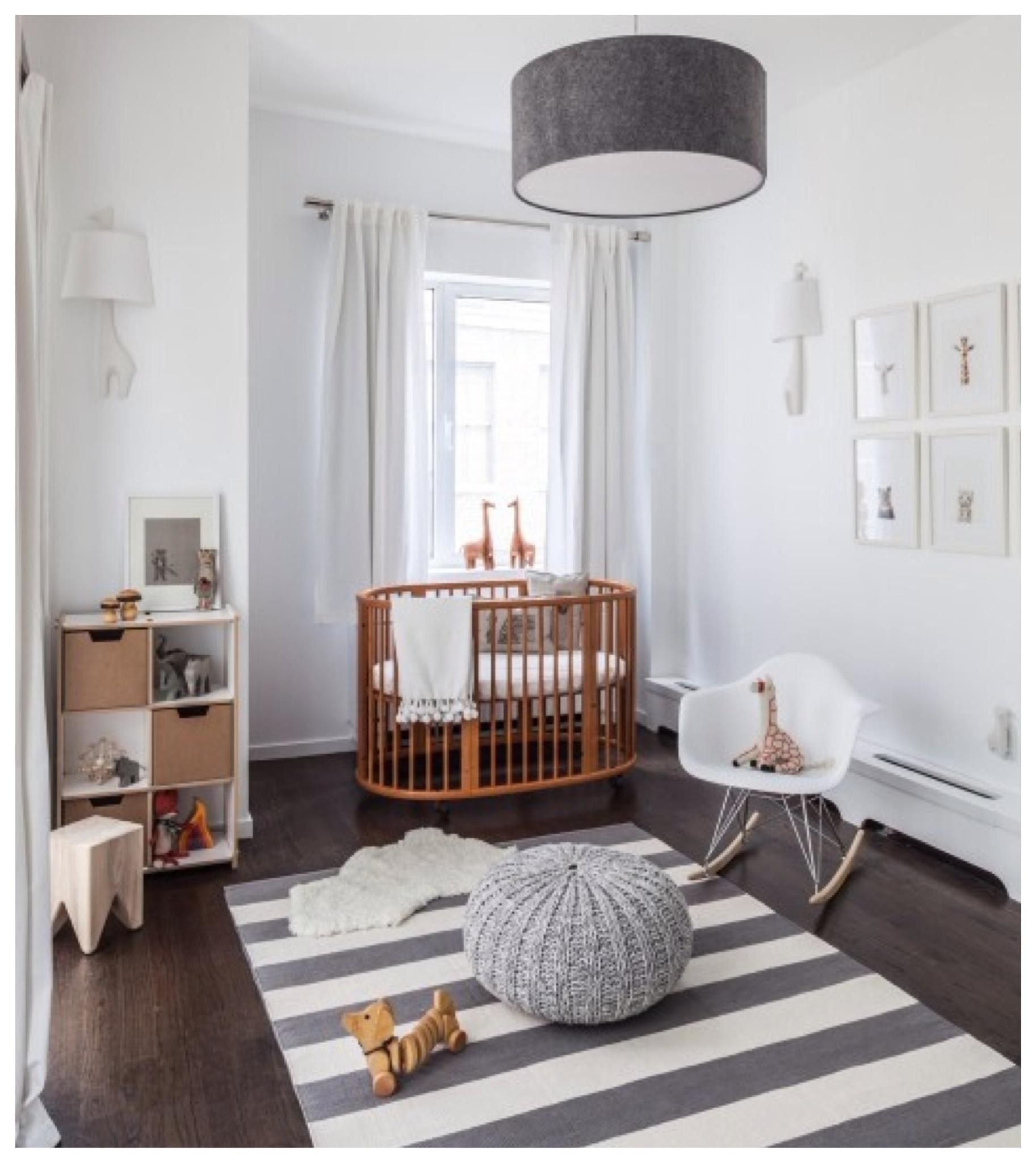 Adorable Baby Nursery Room Designing With Striped Pattern Rug On Dark Wood Flooring And Black