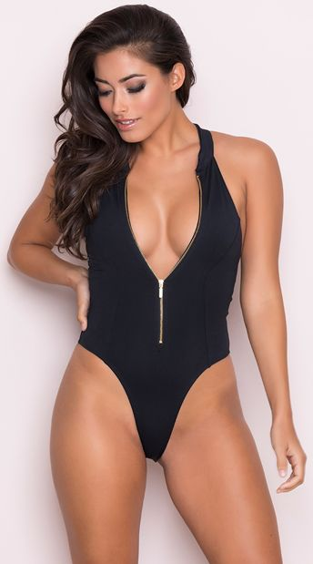 98bc8275a86 Hit the beach in this exclusive black swimsuit featuring a high neck zipper  closure, a racerback, high cut sides, and a cheeky cut back. Yandy Beach  Babe ...