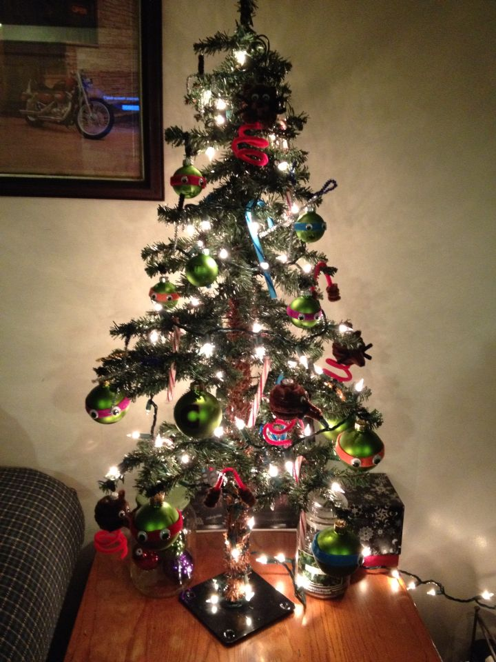 TMNT Christmas themed tree. Splinter, turtles, weapons and the can of ooze as a topper ( not in picture due to it drying)