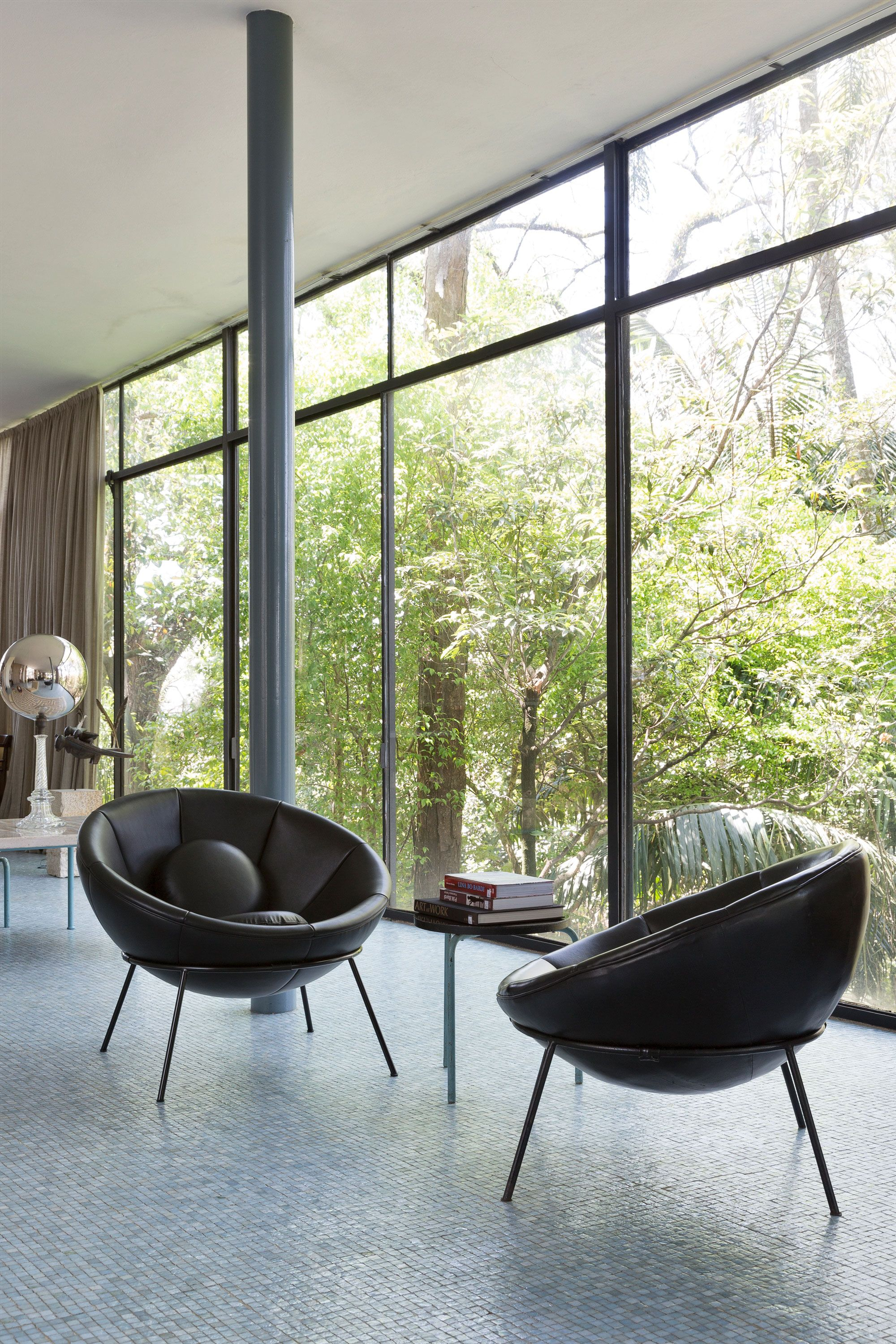 Lina bo bardi bowl chairs installed at her famed glass house