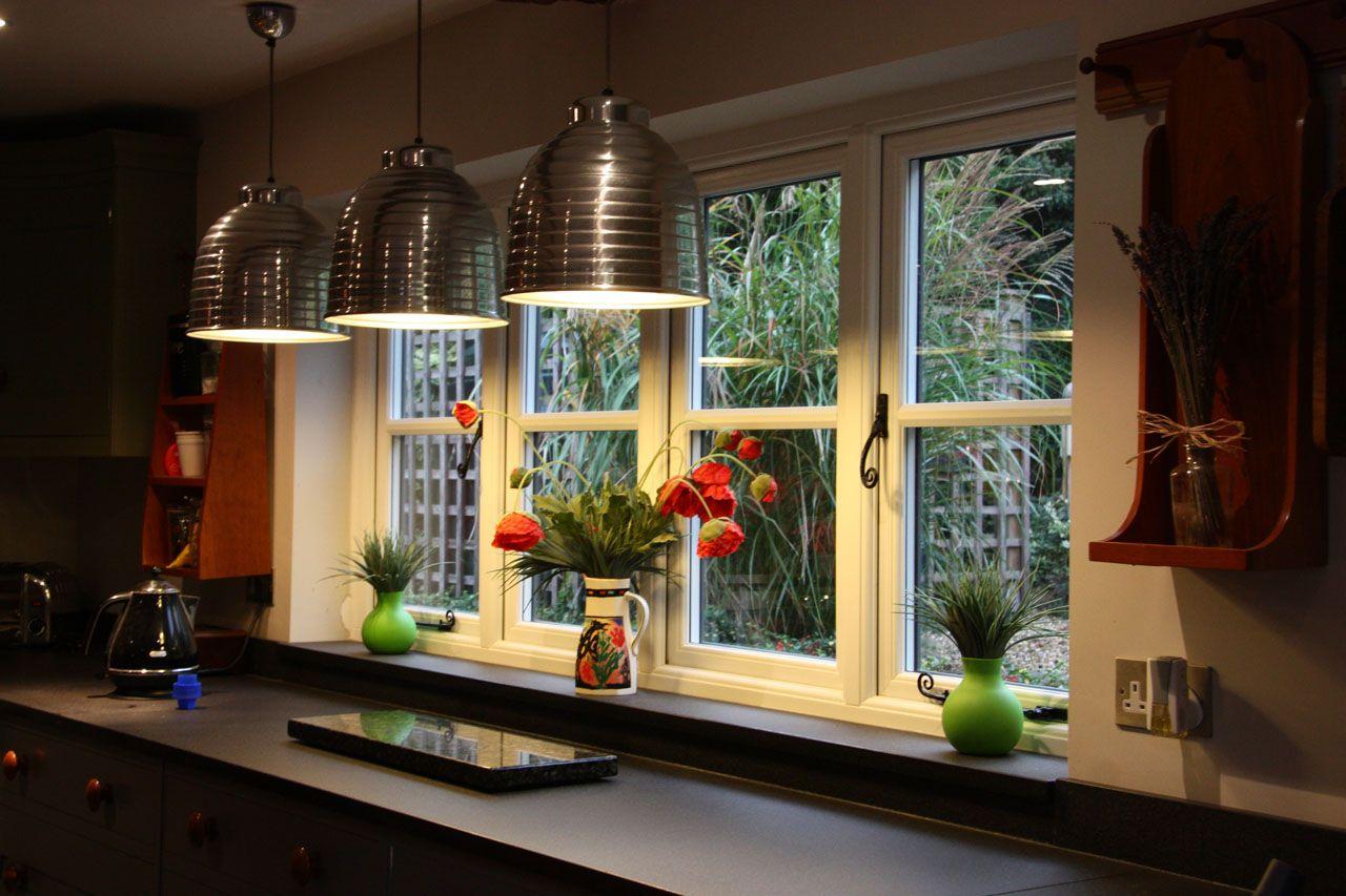 Sliding window over kitchen sink  cottage style upvc windows  gardinia upvc windows u double glazing