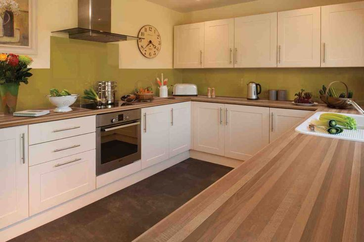 Cream gloss kitchen oak worktop google search kitchens for Cream kitchen ideas