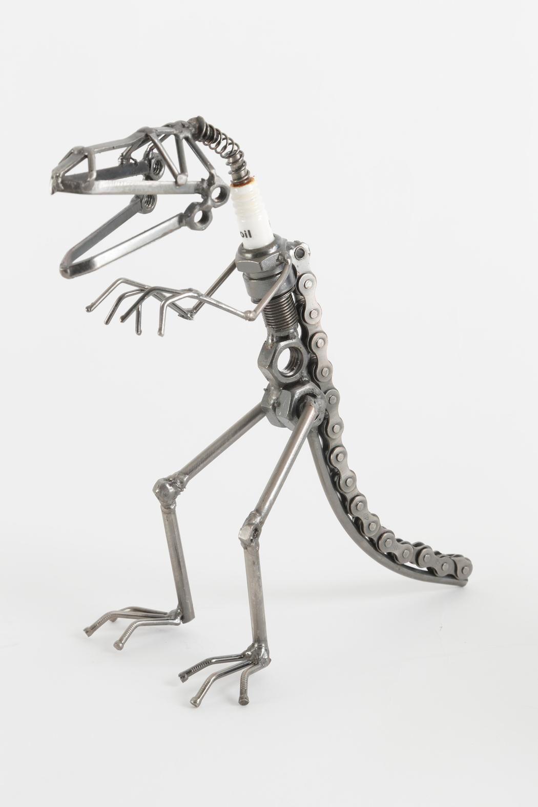 yard birds sparkplug t rex sculpture bikes sculpture and bike chain