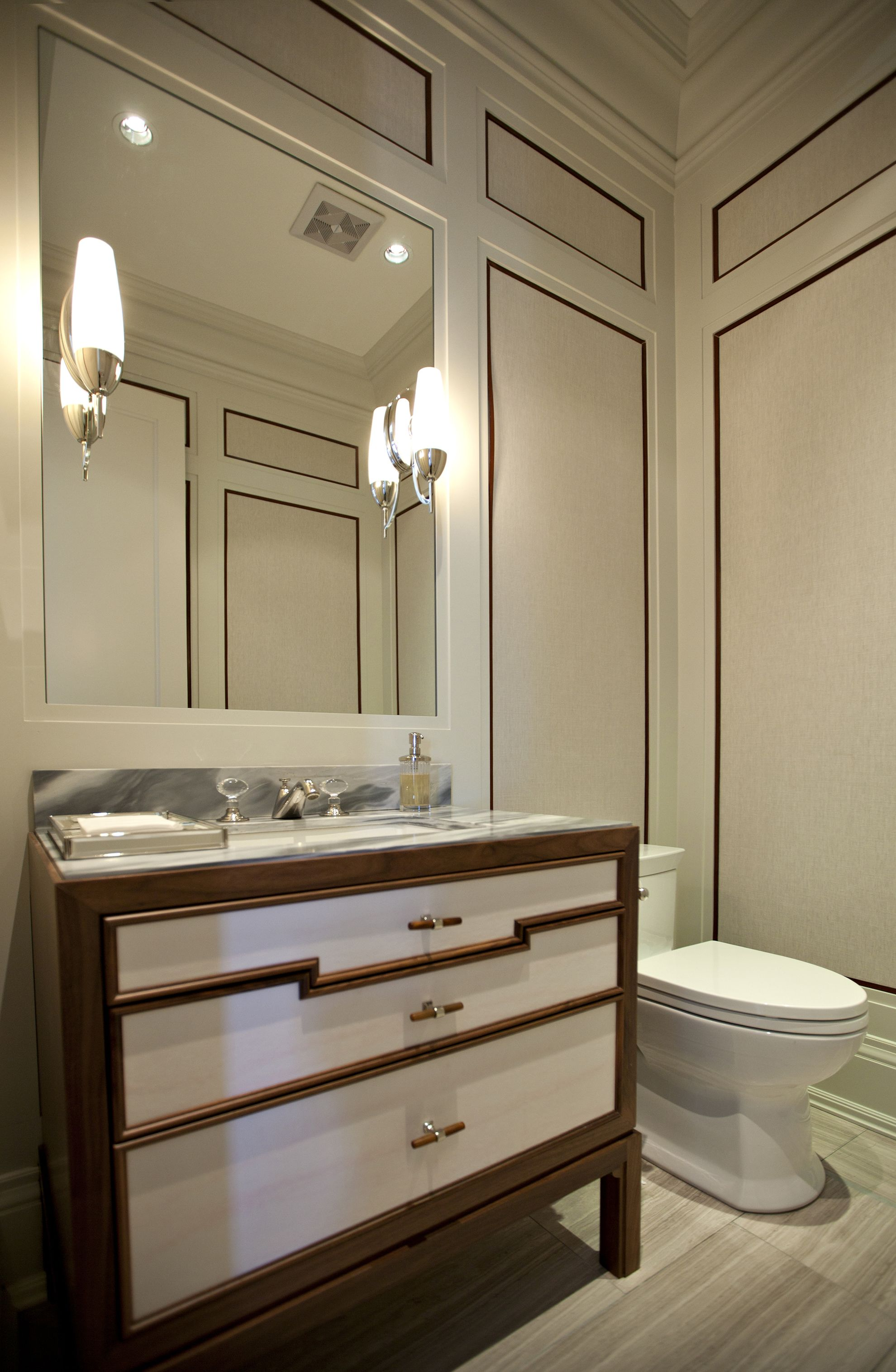 Unique Powder Room Vanity surrounded with panelled walls ...