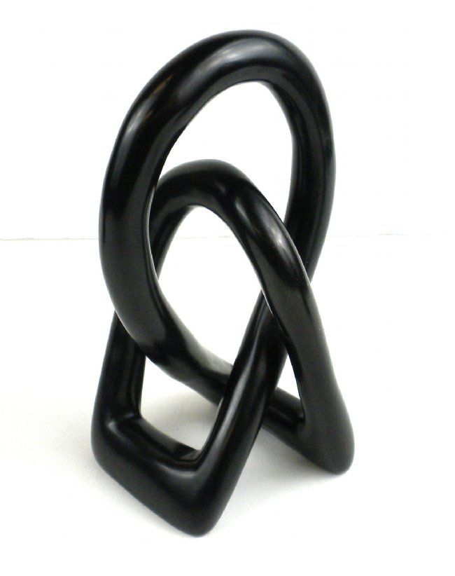 Handcarved from soapstone, these sculptures feature a representation of two lovers. The piece is carved from one piece of soapstone.Please allow for variations. Country of Origin: Kenya regladeoro.com Art Gallery & Fair Trade Gifts Valentine's Day, soapstone, sculpture, home goods, Kenya