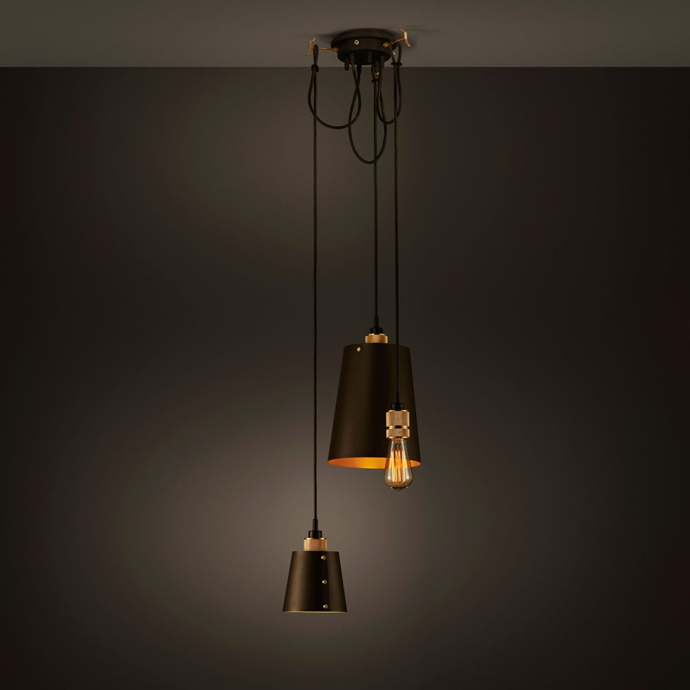 A chandelier made up of three light pendants all with their own