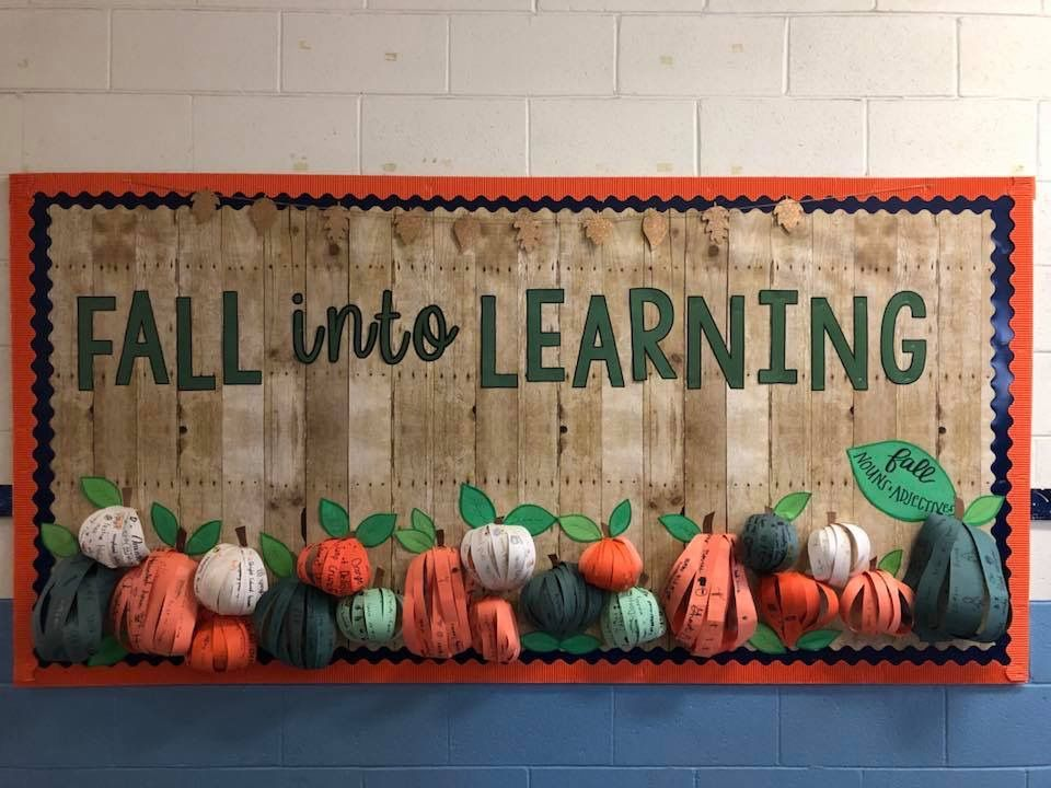Fall into Learning October bulletin board! Students used nouns and adjectives to describe all things fall on strips of paper before they were assembled to create 3D pumpkins! #octoberbulletinboards