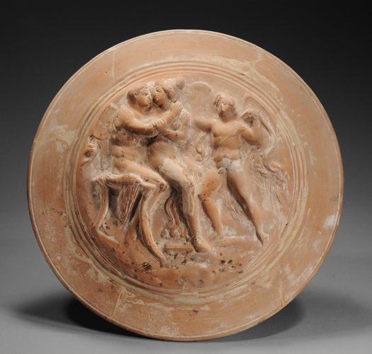 CANOSAN LARGE CIRCULAR POTTERY PYXIS  With a cylindrical body and splayed foot, the domed lid molded in relief with an embracing couple seated on a stool, the man nude, his mantle below, the drapery hanging from the chair, his right arm crossing the woman with his hand on her shoulder; to the right a large winged Eros.  3rd Century BC