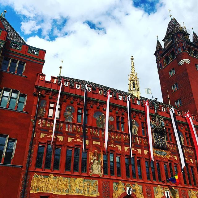 The Basel Town Hall or Rathaus on a sunny day.Basel is hosting the UEFA Europa League Final (Football) match today and the city has been in a football frenzy this week! Liverpool and Sevilla are ready to face each other in the finals and Basel is oozing w