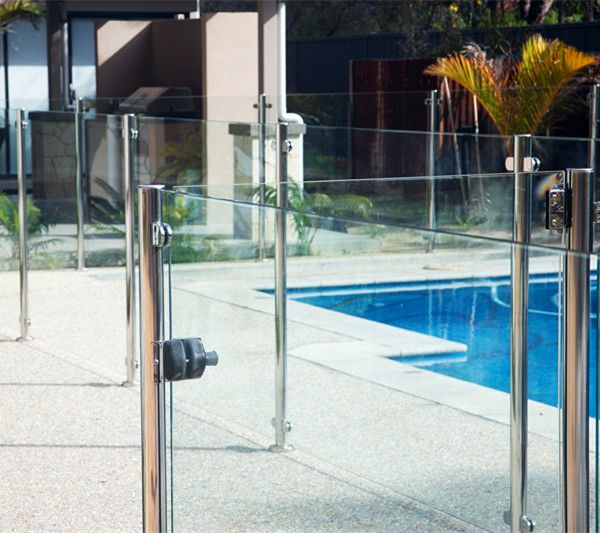 Semi frameless glass pool fence design with stainless for Designer glass pool fencing