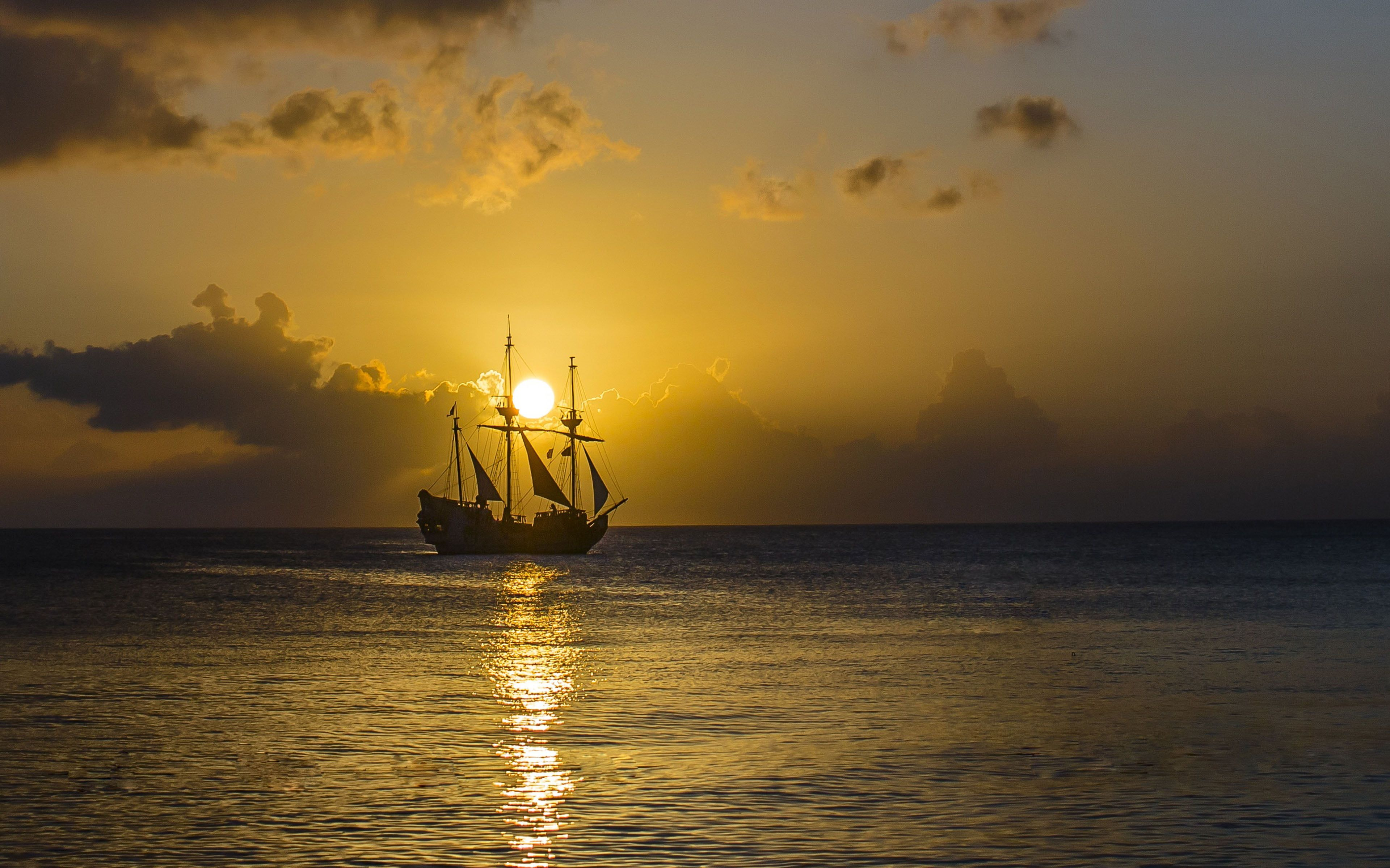 Gold Sunset Ocean Old Pirate Ship With Sail Sky 4k Ultra Hd Wallpaper For Desktop Mobile And Computer 3840 2400 4k Gold Sunset Hd Wallpaper Desktop Wallpaper Wallpaper sunset sea boat sky coast