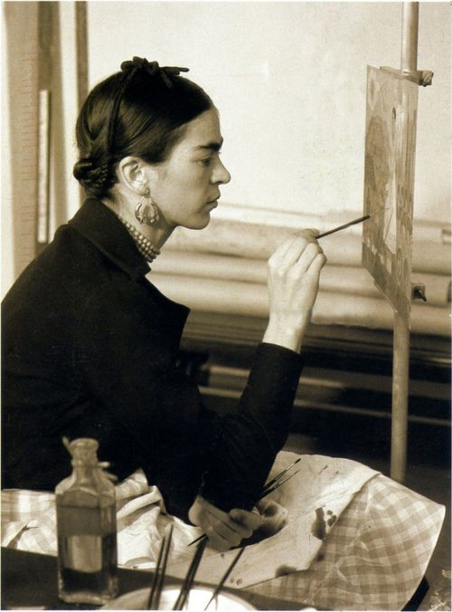 Frida Kahlo painting Self-portrait on the Borderline between Mexico and the United States, 1932.