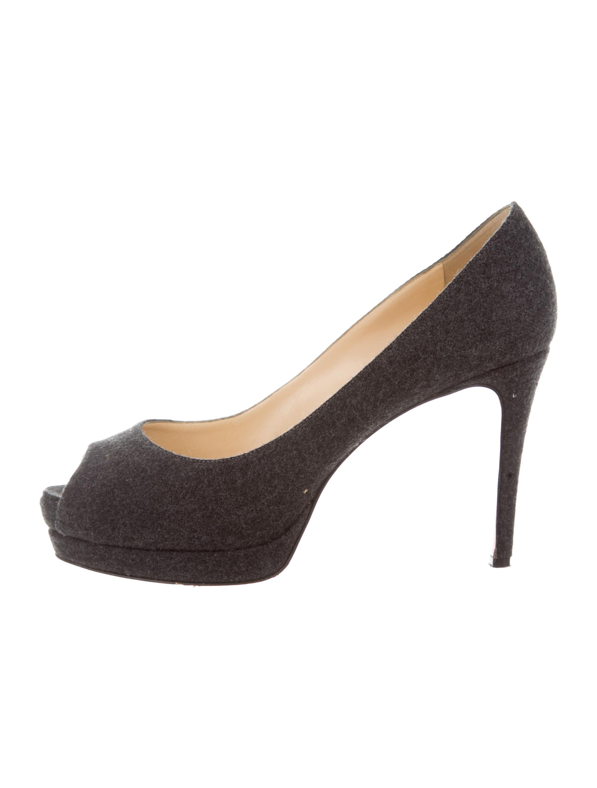 5f7d4e574fe0 Grey felt Christian Louboutin peep-toe pumps with semi concealed platforms  and covered heels.