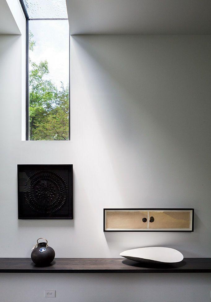 Upstate New York retreat's hallway maple shelf and skylight