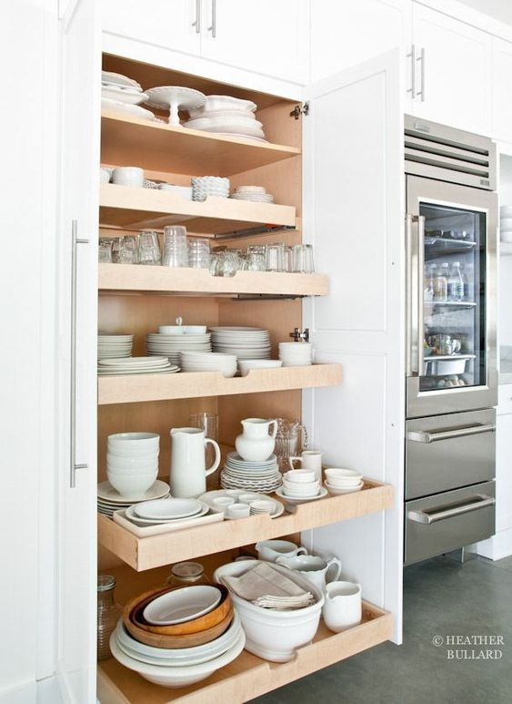 White industrial kitchen with natural wood roll out shelves for white kitchen ware #kitchenware