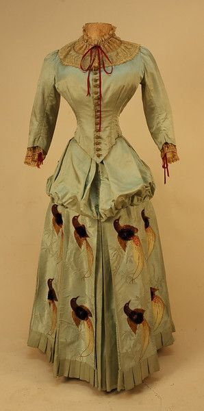 What  a figure! Id love to know the measurements.   SILK BUSTLE DRESS with TUFTED BROCADE BIRDS, 1880's.
