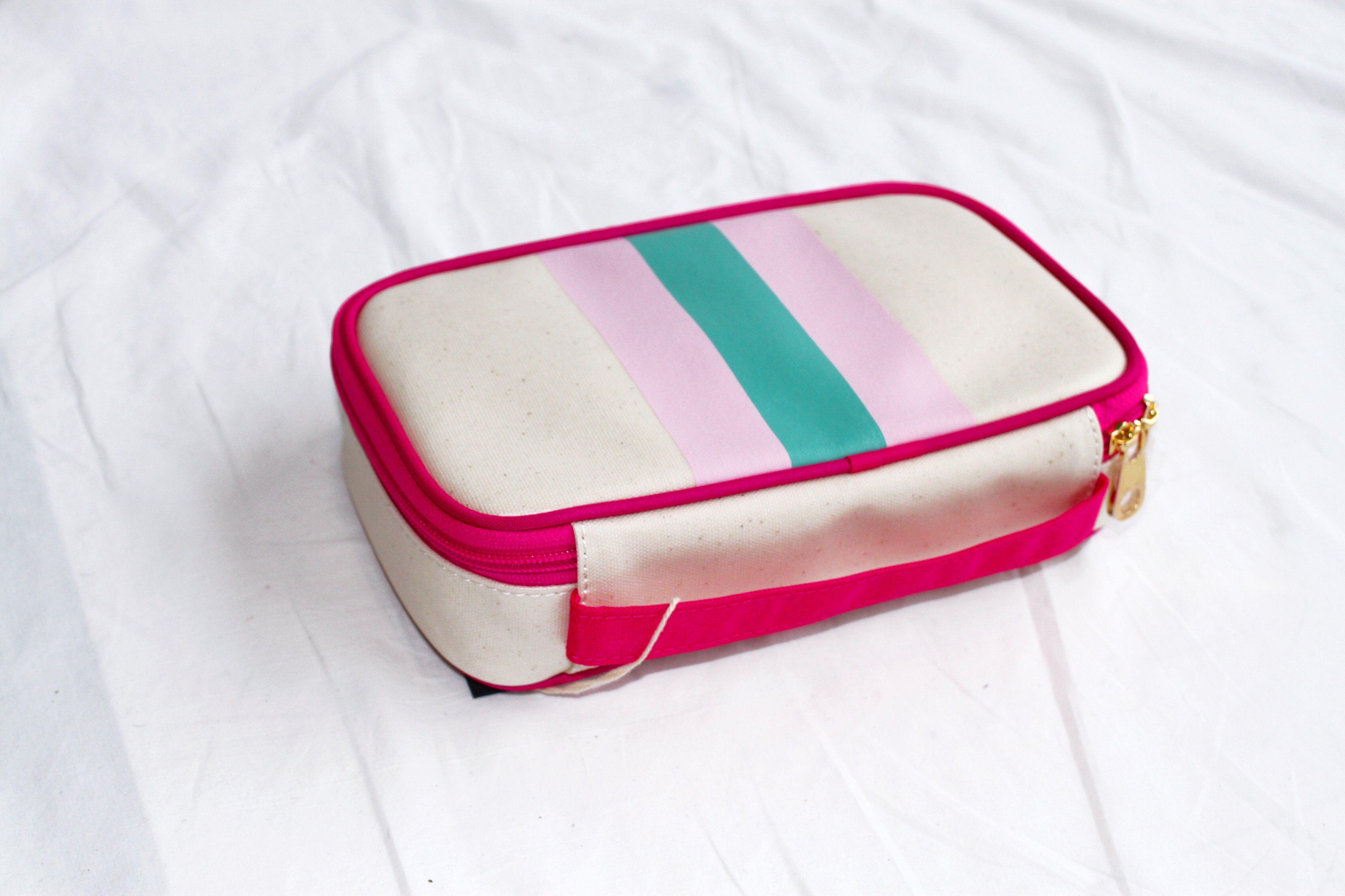 Beschichtete Leinwand mit Make-up-Tasche mit rosa und grünen Streifen