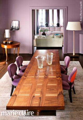 A casa di Romeo Sozzi. In primo piano, tavolo Bassano in palissandro e sedie Molly, di Promemoria.
