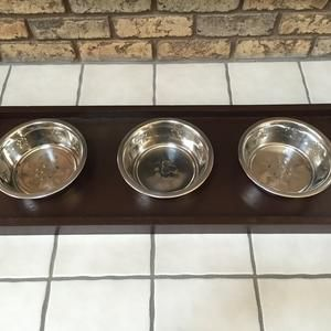 Our shop creates unique home décor. We are a husband & wife team who create handmade beautiful items! Creations by two, pet feeding station