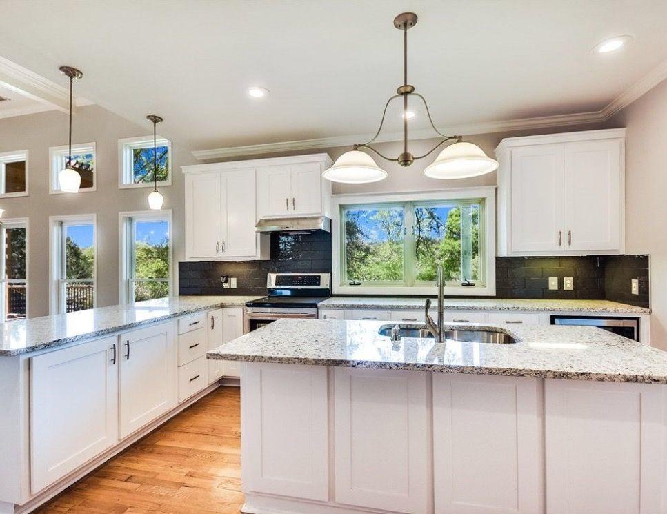 Kitchen: light (white) cabinets, dark backsplash, light ...