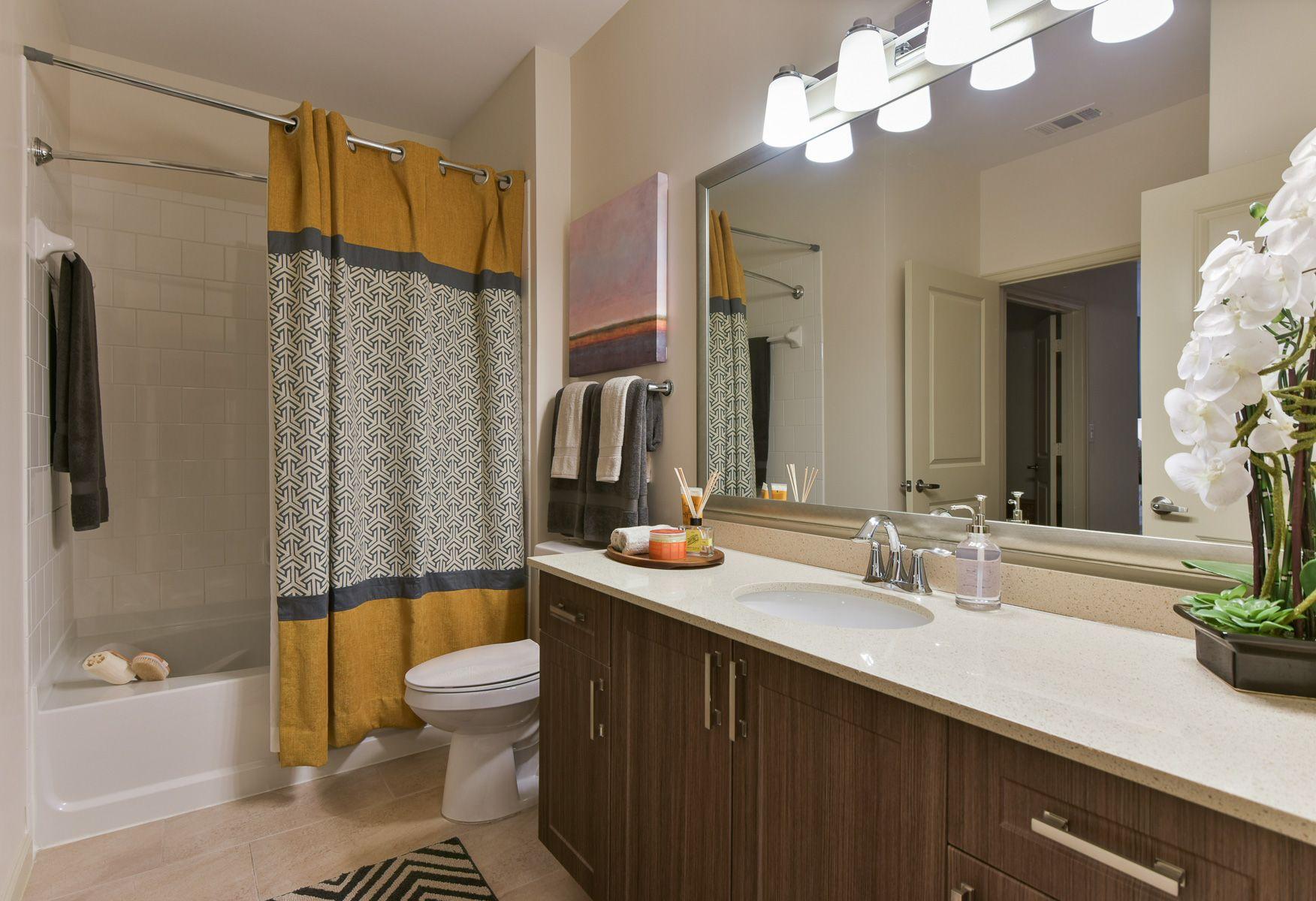Encore Clairmont in bathroom with double vanity
