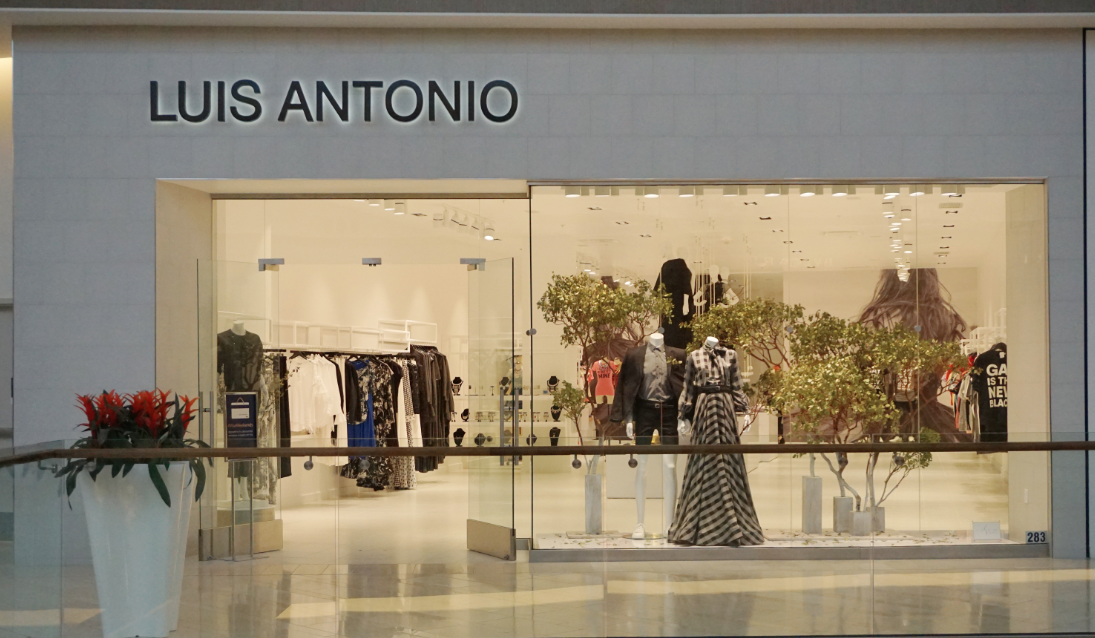 Fall Window Display at Luis Antonio Boutique using real trees by STEM Events