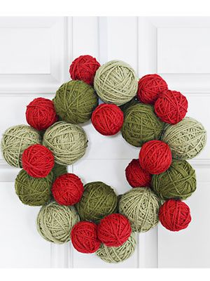 Get crafty this Christmas by wrapping Styrofoam balls with colored yarn to make this wreath. Beautiful and simple! #christmas #decorations