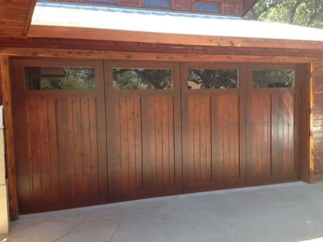 Custom Cedar Garage Door over a Steel commercial frame stained w