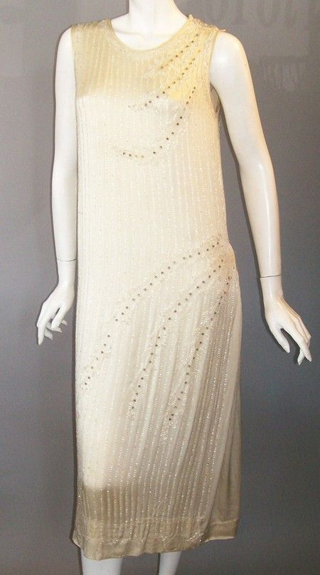 20s flapper dress of ivory silk charmeuse fully beaded