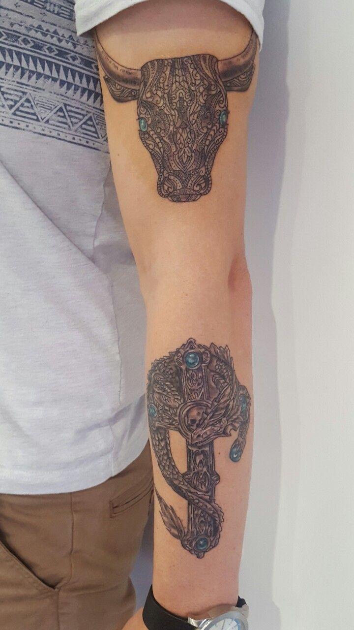 Taurus bull tattoo and Celtic Dragon Tattoo