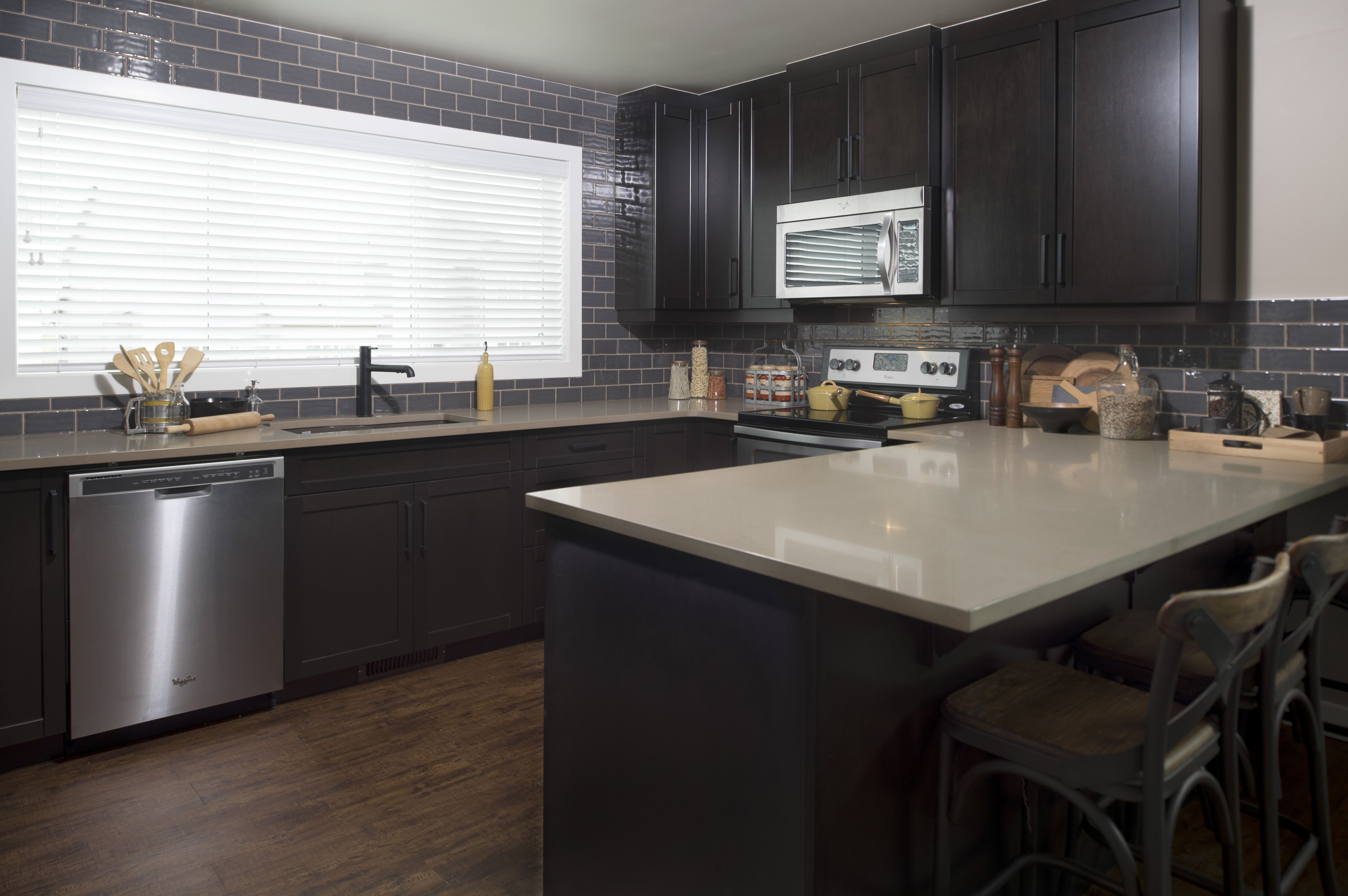 Dark kitchen with beautiful backsplash. kitchen