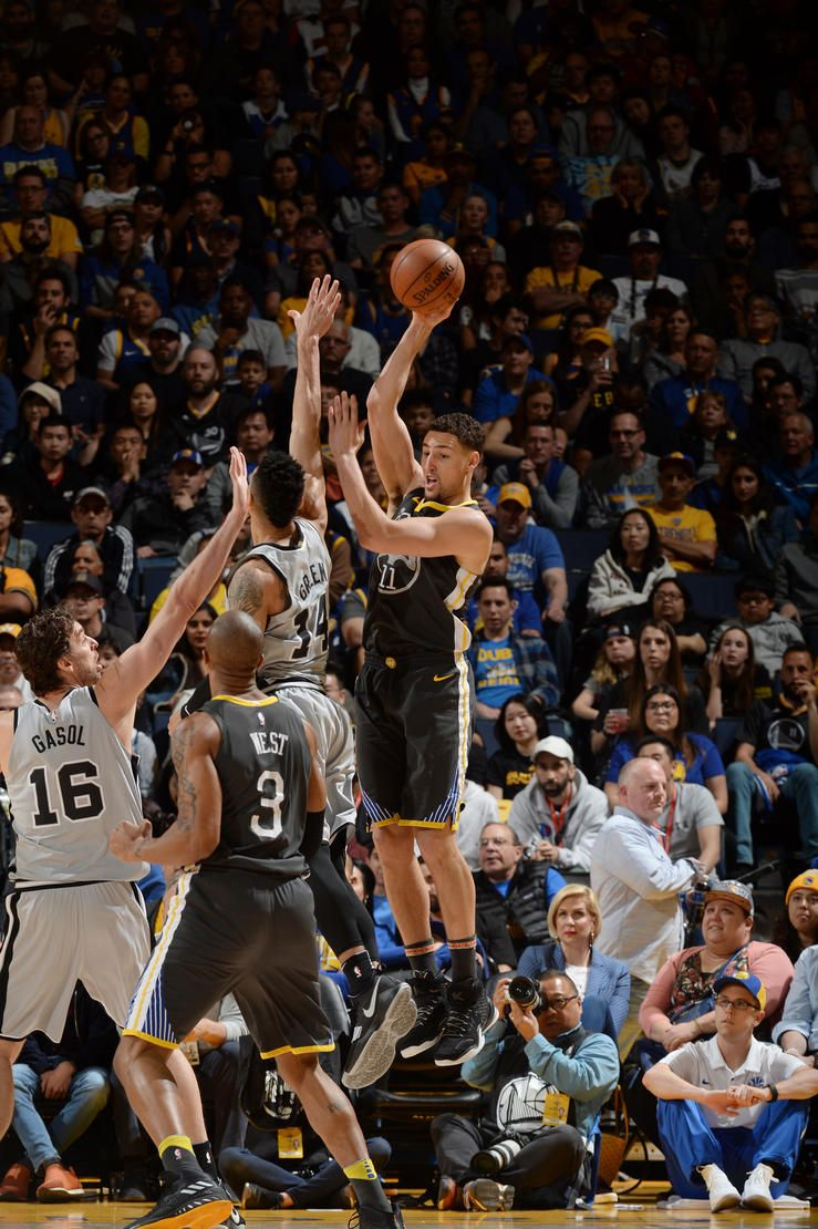 oakland-ca-february-10-klay-thompson-11-of-the-golden-state-warriors-looks-to-pass-against-the-san-antonio-spurs-on-february-10-2018-at-oracle-arena