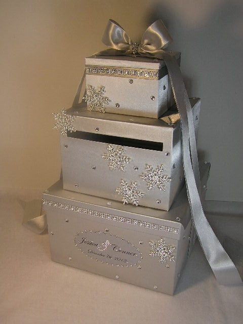 Wrapped, stacked boxes with slot for cards. Decorate with pretty ribbon and large gift tag to The Bride and Groom for gift cards