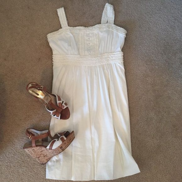 White BCBGMAXAZRIA Dress This BCBGMAXAZRIA dress is the perfect LWD. With faux-buttons down the chest and rusched accents around the waist and neckline, this bubble skirt dress is the quintessential addition to any wardrobe. BCBGMaxAzria Dresses Mini