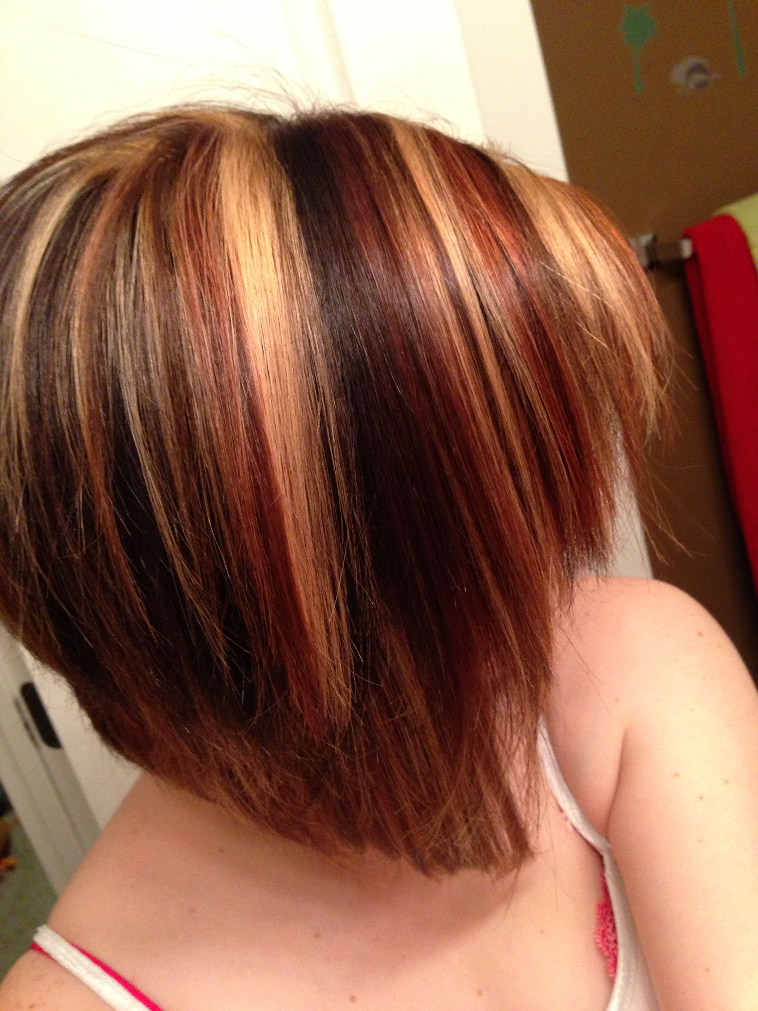 Angled bob short cut with red and blonde highlights hair and