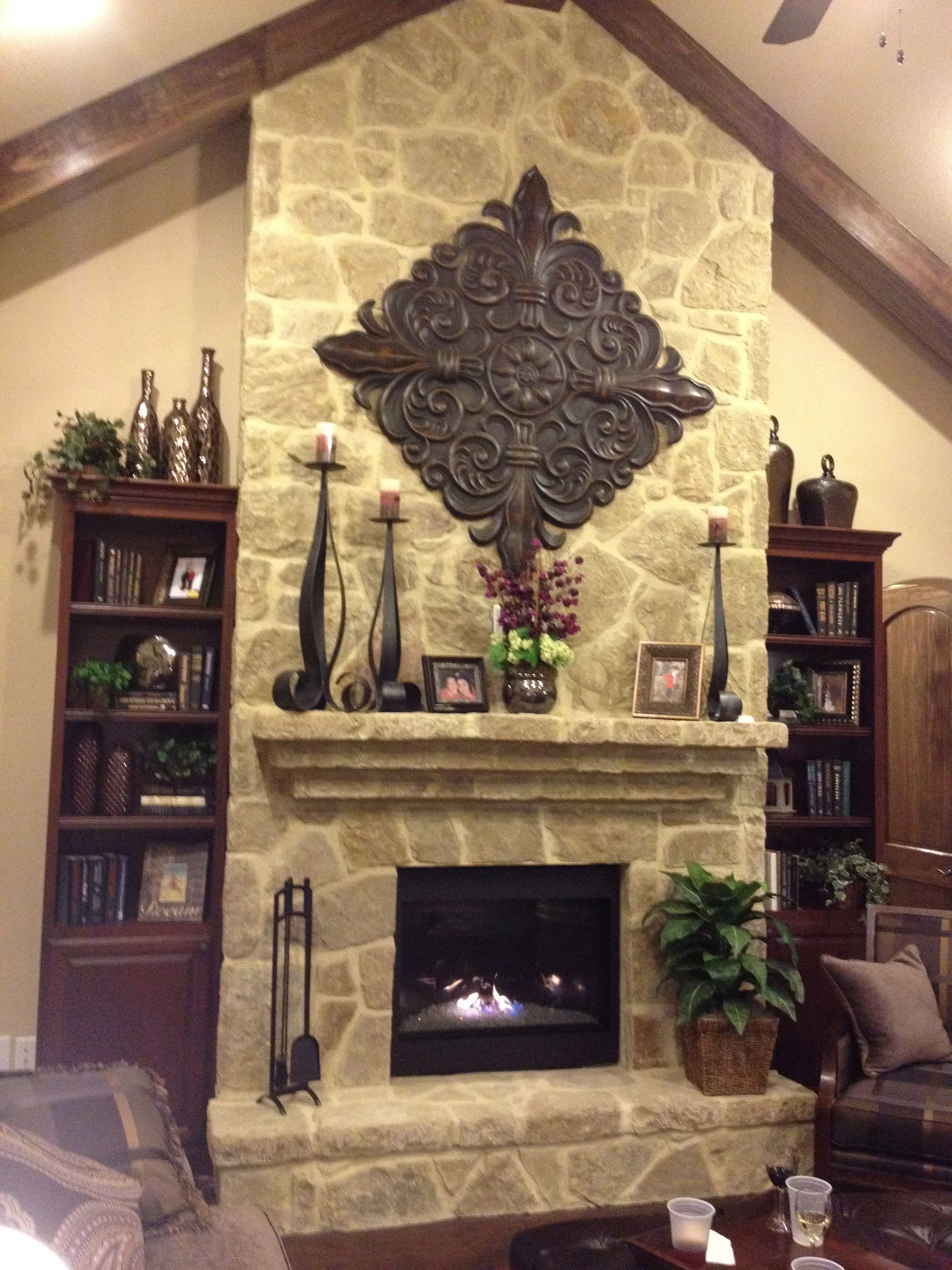 Nice matching mantel with the extra details and matching hearth ...