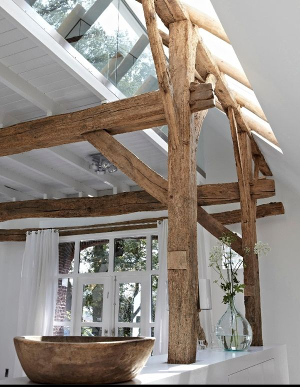 Natural wood beams, painted white surfaces and daylight.