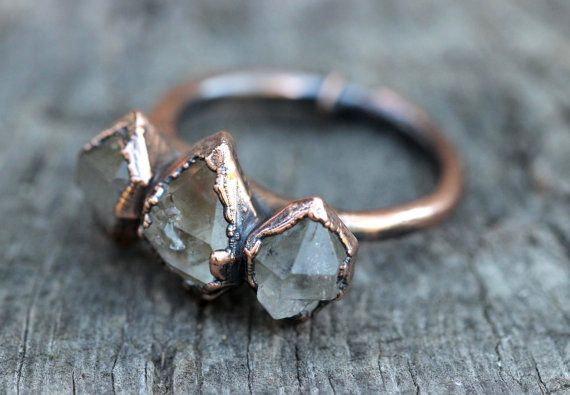 Raw Crystal Ring Quartz Crystal Ring Herkimer Diamond Ring Raw Crystals and Stones Natural Stone Jewelry Crystal Crown Ring Quartz Ring Size 8.75  This quartz crystal ring is gorgeously organic and rustic. It features three herkimer diamond crystal points inside of copper. Some are icy clear and some have black tourmaline inclusions. It is like something worn by an ancient tribal queen! I created the ring with a technique called electroforming. Copper is deposited over the stone over 12-24…