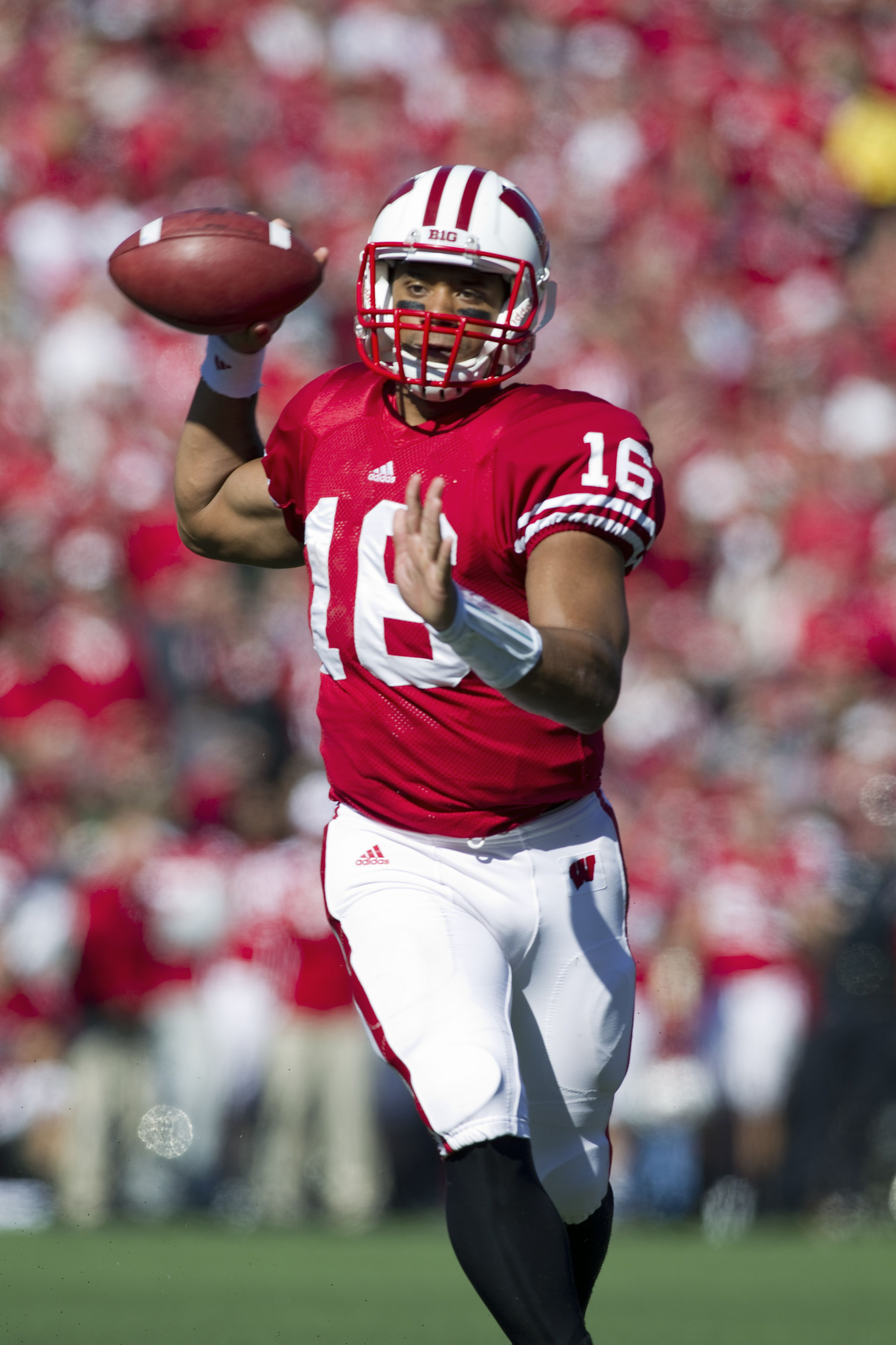 get cheap 4e32c e57ed Russell Wilson quarterbacked the Badgers in 2011. After ...