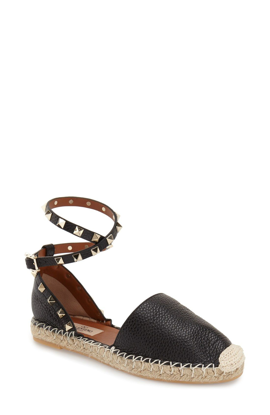 This chic espadrille sandal that includes an ankle strap with gold pyramid  studs will be the
