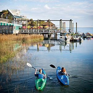 Southern Living calls Tybee Island, GA the perfect beach town with century-old lighthouses, dockside restaurants and charming cottages in a quaint town. 30 minutes from Savannah with lots of shrimp (AJ's Dockside at sunset) & crab cakes (North Beach Bar & Grill) places to eat.