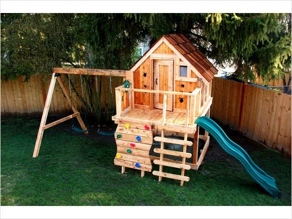 Very nice play structure with cabin and rock climbing wall ...