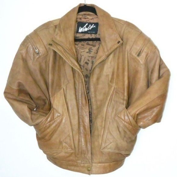 """Vintage Camel Tan Leather Bomber Jacket Coat Incredible tan brown leather vintage bomber jacket with zipper sleeve detail and elastic waistband in the back. Very good condition, with some """"lived in"""" signs of wear on the leather sleeves. + Size Medium  + 100% Genuine Leather outer  + 100% Nylon Taffeta lining Vintage Jackets & Coats Utility Jackets"""