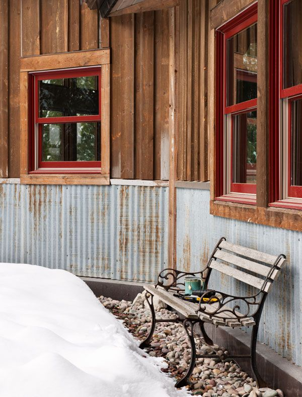 Reclaimed Corrugated Metal Makes Totally Bomb Proof Exterior Wainscoting That Helps Protect The Lower Part Of The Rustic Exterior Timber House House Exterior