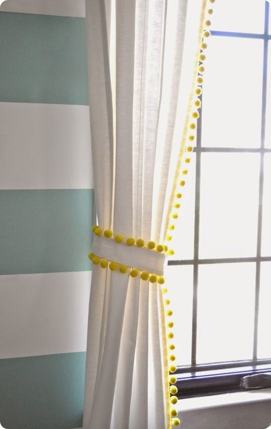 Neon Yellow Trim With Dangling Pom Poms Adds Fun To This