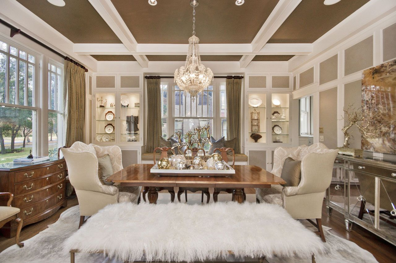 fun gold living room decor. A beautiful and chic dining room redesign  lots of light FUN mongolian lamb wool