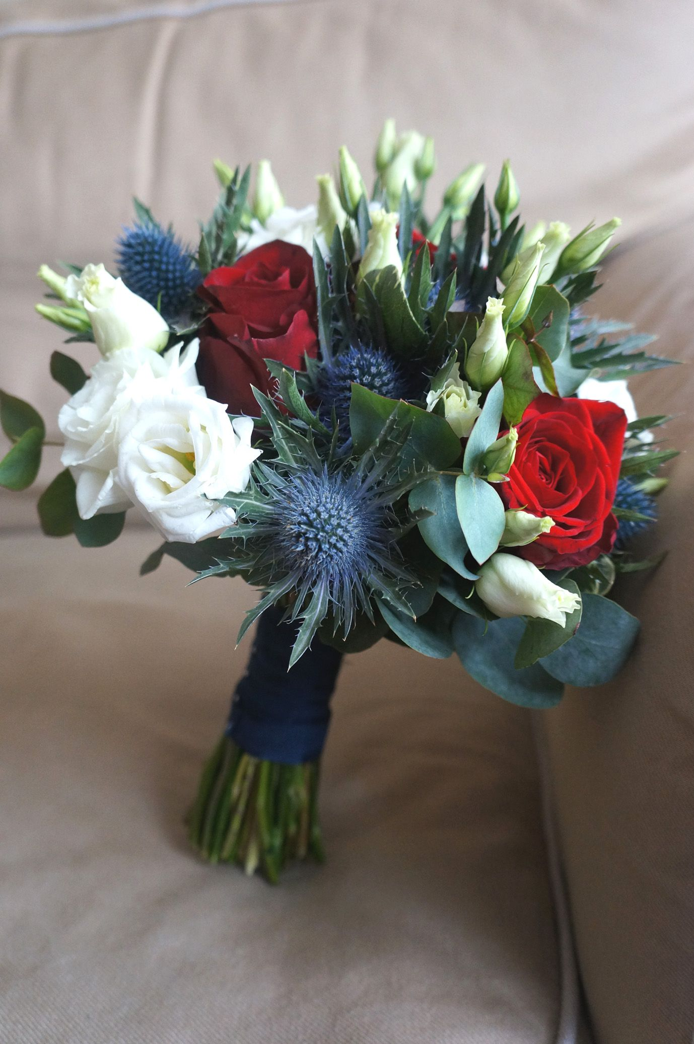 Blue White Red Bridal Bouquet Lisianthus Roses And Thistles